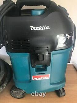 Makita 240v Dust extractor wet and dry hoover class L with hoses and bags